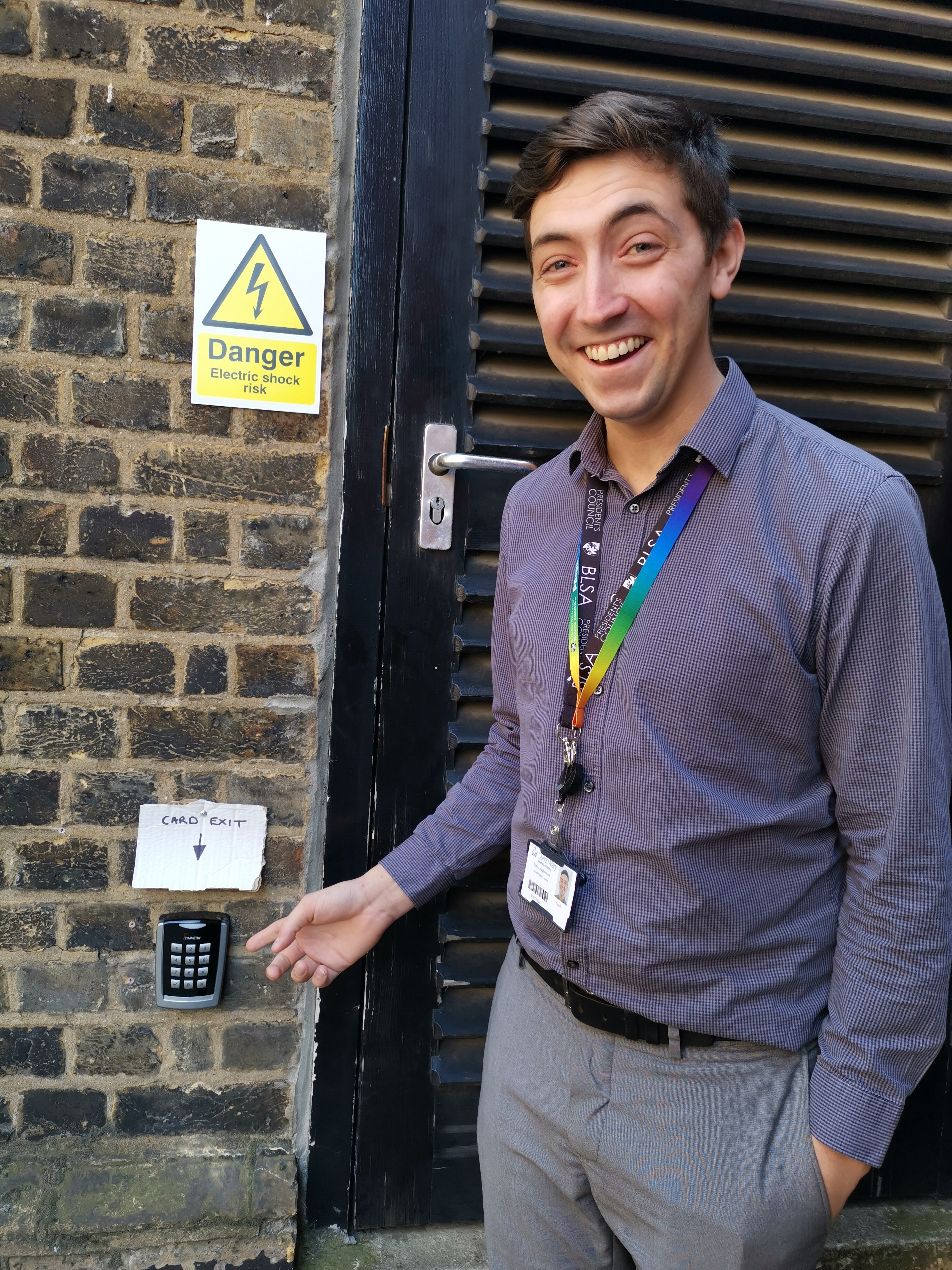 """Tom pointing at a card reader marked """"Card Exit"""""""
