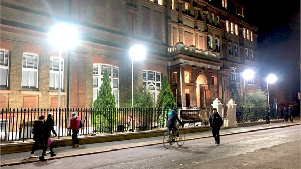 The Garrod Building at night, lit up with the new streetlights